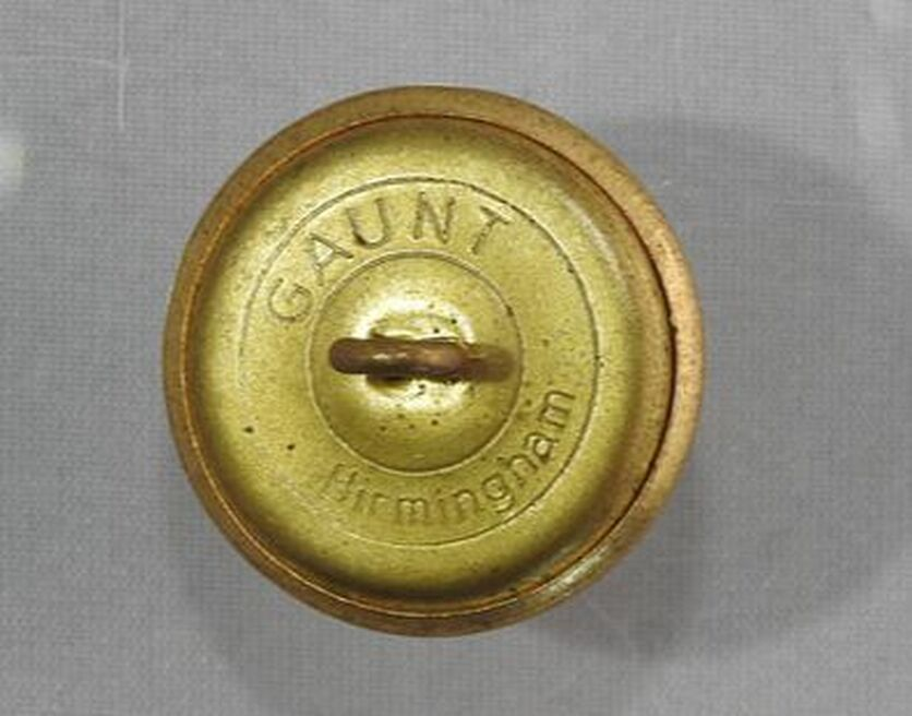 An example of Trinity House uniform buttons. The top button from the uniform of Trinity House Pilot with rope design surround. The bottom button showing the Trinity House Coat of Arms with rope detail edge. From the Following The Lights Collection. ©Peter Gellatly 2020.